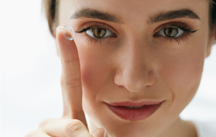 Girl Holding Contact Lens